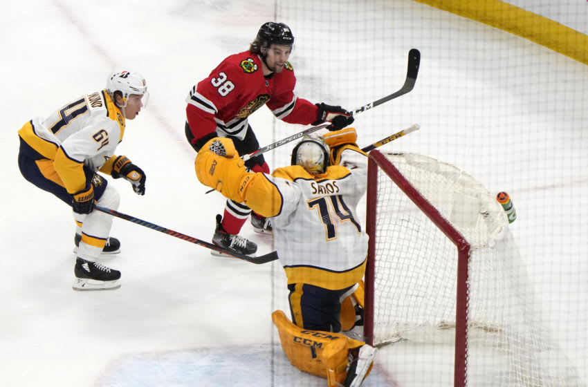 Chicago Blackhawks left wing Brandon Hagel (38) scores the winning goal during overtime at the United Center. Mandatory Credit: Mike Dinovo-USA TODAY Sports