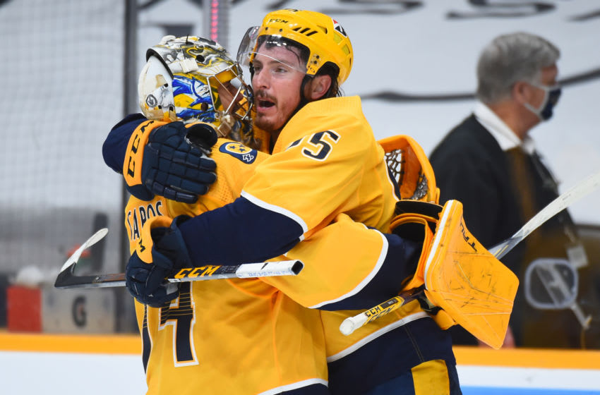 Nashville Predators center Matt Duchene (95) celebrates with goaltender Juuse Saros (74) after scoring the game-winning goal in the second overtime against the Carolina Hurricanes in game three of the first round of the 2021 Stanley Cup Playoffs at Bridgestone Arena. Mandatory Credit: Christopher Hanewinckel-USA TODAY Sports