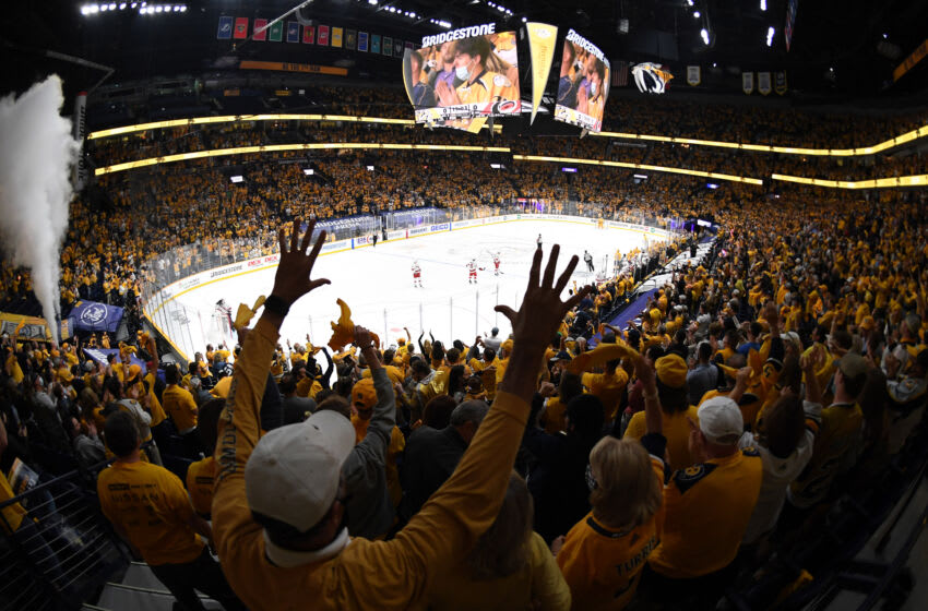 May 23, 2021; Nashville, Tennessee, USA; Nashville Predators fans celebrate after a goal by Nashville Predators center Luke Kunin (11) during the first period against the Carolina Hurricanes in game four of the first round of the 2021 Stanley Cup Playoffs at Bridgestone Arena. Mandatory Credit: Christopher Hanewinckel-USA TODAY Sports