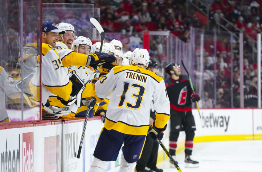 May 25, 2021; Raleigh, North Carolina, USA; Nashville Predators center Yakov Trenin (13) is congratulated after his second period goal against the Carolina Hurricanes in game five of the first round of the 2021 Stanley Cup Playoffs at PNC Arena. Mandatory Credit: James Guillory-USA TODAY Sports