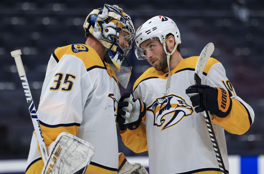 Nashville Predators goaltender Pekka Rinne (35) celebrates with center Calle Jarnkrok (19) after defeating the Columbus Blue Jackets at Nationwide Arena. Mandatory Credit: Aaron Doster-USA TODAY Sports