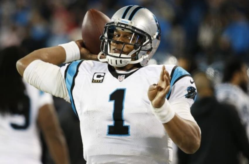 Jan 24, 2016; Charlotte, NC, USA; Carolina Panthers quarterback Cam Newton (1) passes on the sideline during the fourth quarter against the Arizona Cardinals in the NFC Championship football game at Bank of America Stadium. Mandatory Credit: Jason Getz-USA TODAY Sports