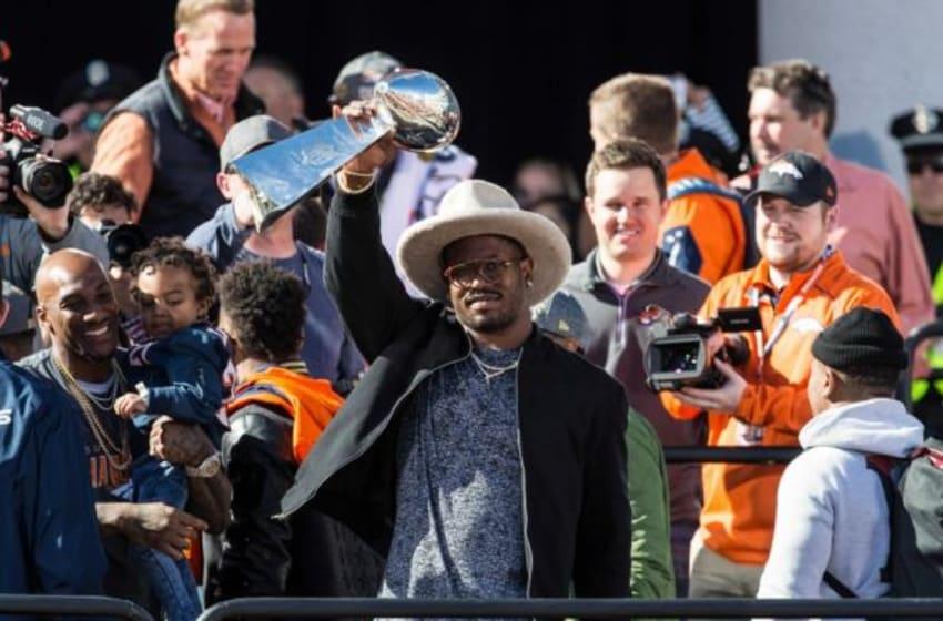 Feb 9, 2016; Denver, CO, USA; Denver Broncos outside linebacker Von Miller (58) lifts the Vince Lombardi Trophy during the Super Bowl 50 championship parade celebration at Civic Center Park. Mandatory Credit: Isaiah J. Downing-USA TODAY Sports