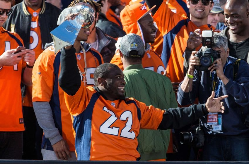 Feb 9, 2016; Denver, CO, USA; Denver Broncos running back C.J. Anderson (22) lifts the Vince Lombardi Trophy during the Super Bowl 50 championship parade celebration at Civic Center Park. Mandatory Credit: Isaiah J. Downing-USA TODAY Sports