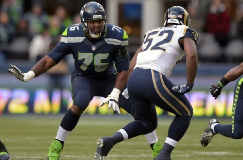 Dec 28, 2014; Seattle, WA, USA; Seattle Seahawks left tackle Russell Okung (76) defends against St. Louis Rams linebacker Alec Ogletree (52) at CenturyLink Field. Mandatory Credit: Kirby Lee-USA TODAY Sports