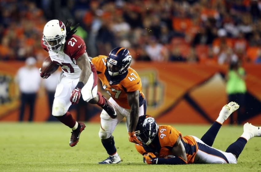 Sep 3, 2015; Denver, CO, USA; Arizona Cardinals running back Chris Johnson (27) is pursued by Denver Broncos linebackers Zaire Anderson (47) and Gerald Rivers (99) during the first half at Sports Authority Field at Mile High. Mandatory Credit: Chris Humphreys-USA TODAY Sports