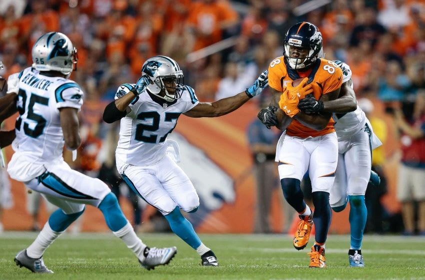 Sep 8, 2016; Denver, CO, USA; Denver Broncos wide receiver Demaryius Thomas (88) runs the ball against Carolina Panthers cornerback James Bradberry (24) and defensive back Robert McClain (27) in the third quarter at Sports Authority Field at Mile High. Mandatory Credit: Isaiah J. Downing-USA TODAY Sports