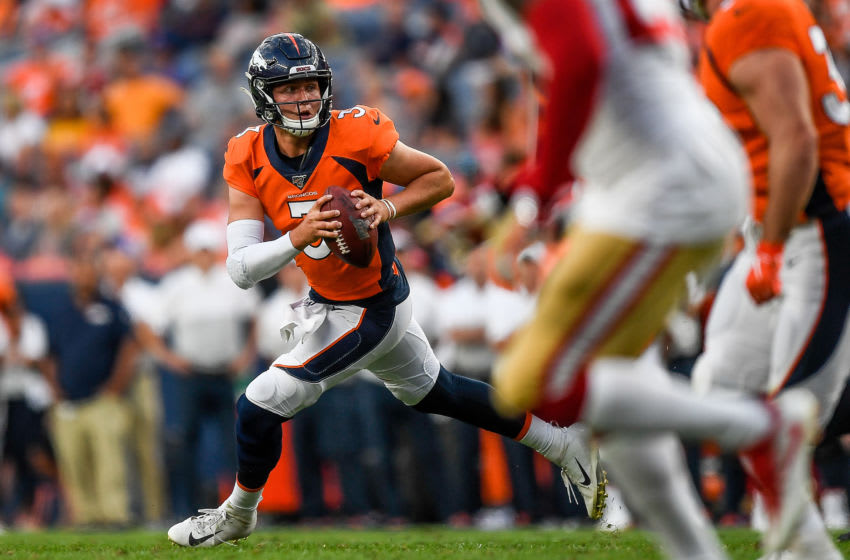 DENVER, CO - AUGUST 19: Quarterback Drew Lock #3 of the Denver Broncos rolls out of the pocket against the San Francisco 49ers in the second quarter during a preseason National Football League game at Broncos Stadium at Mile High on August 19, 2019 in Denver, Colorado. (Photo by Dustin Bradford/Getty Images)