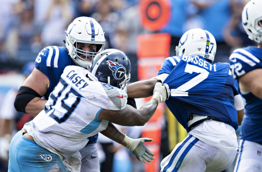 NASHVILLE, TN - SEPTEMBER 15: Jacoby Brissett #7 of the Indianapolis Colts is grabbed by the shirt by Jurrell Casey #99 of the Tennessee Titans at Nissan Stadium on September 15, 2019 in Nashville,Tennessee. The Colts defeated the Titans 19-17. (Photo by Wesley Hitt/Getty Images)