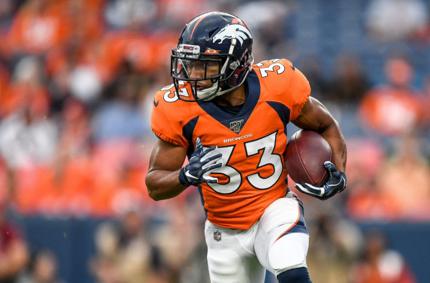 DENVER, CO - AUGUST 29: Khalfani Muhammad #33 of the Denver Broncos rushes against the Arizona Cardinals in the first quarter during a preseason National Football League game at Broncos Stadium at Mile High on August 29, 2019 in Denver, Colorado. (Photo by Dustin Bradford/Getty Images)