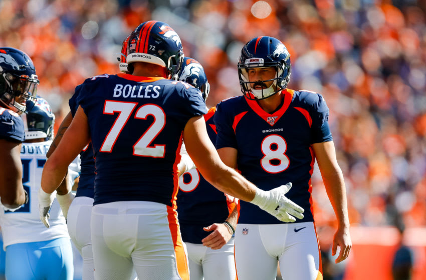 DENVER, CO - OCTOBER 13: Kicker Brandon McManus #8 of the Denver Broncos celebrates with offensive tackle Garett Bolles #72 after kicking a field goal during the first quarter against the Tennessee Titans at Empower Field at Mile High on October 13, 2019 in Denver, Colorado. (Photo by Justin Edmonds/Getty Images)
