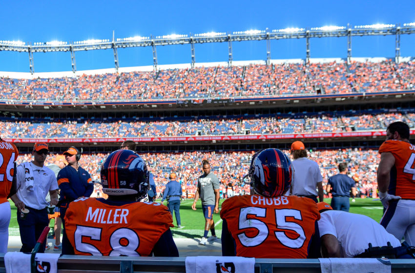 DENVER, CO - SEPTEMBER 29: Von Miller #58 and Bradley Chubb #55 of the Denver Broncos sit on the bench in the second quarter of a game against the Jacksonville Jaguars at Empower Field at Mile High on September 29, 2019 in Denver, Colorado. (Photo by Dustin Bradford/Getty Images)