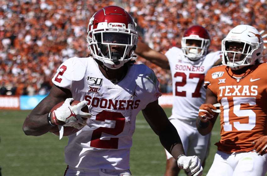 DALLAS, TEXAS - OCTOBER 12: CeeDee Lamb #2 of the Oklahoma Sooners runs for a touchdown against the Texas Longhorns in the third quarter during the 2019 AT&T Red River Showdown at Cotton Bowl on October 12, 2019 in Dallas, Texas. (Photo by Ronald Martinez/Getty Images)