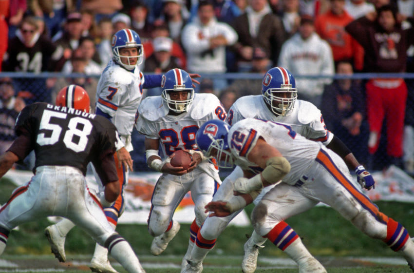 Gaston Green runs through a hole during a game against Cleveland on December 8, 1991.