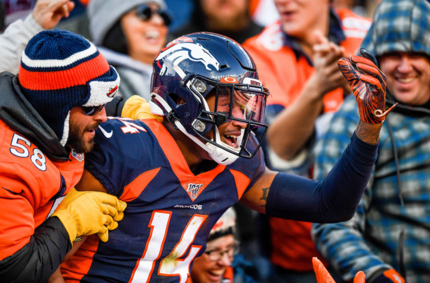 DENVER, CO - DECEMBER 1: Courtland Sutton #14 of the Denver Broncos is congratulated by fans after a first quarter touchdown catch against the Los Angeles Chargers at Empower Field at Mile High on December 1, 2019 in Denver, Colorado. (Photo by Dustin Bradford/Getty Images)