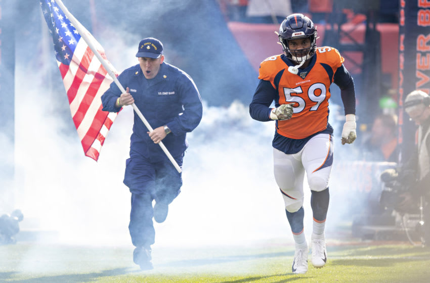 DENVER, CO - NOVEMBER 3: Malik Reed #59 of the Denver Broncos runs onto the field with a soldier before a game against the Cleveland Browns at Broncos Stadium at Mile High on November 3, 2019 in Denver, Colorado. The Broncos defeated the Browns 24-19. (Photo by Wesley Hitt/Getty Images)