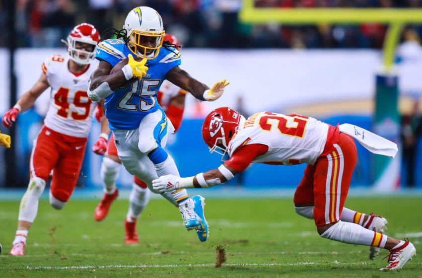 MEXICO CITY, MEXICO - NOVEMBER 18: Safety Juan Thornhill #22 of the Kansas City Chiefs tackles Running back Melvin Gordon #25 of Los Angeles Chargers during the first half of a match against Los Angeles Chargers at Estadio Azteca on November 18, 2019 in Mexico City, Mexico. (Photo by Manuel Velasquez/Getty Images)