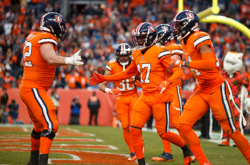 DENVER, CO - DECEMBER 22: Wide receiver DaeSean Hamilton #17 of the Denver Broncos celebrates a touchdown reception with offensive tackle Garett Bolles #72 and teammates during the fourth quarter against the Detroit Lions at Empower Field at Mile High on December 22, 2019 in Denver, Colorado. The Broncos defeated the Lions 27-17. (Photo by Justin Edmonds/Getty Images)
