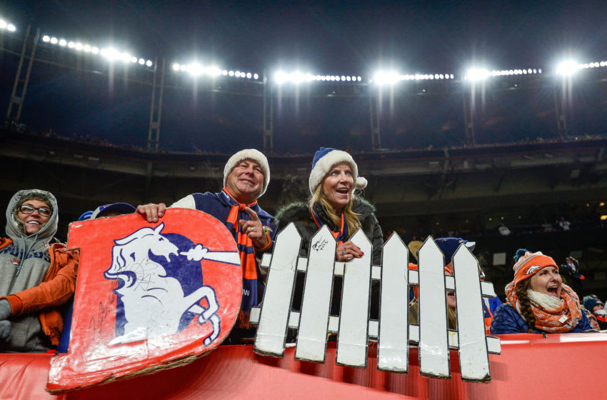 DENVER, CO - DECEMBER 29: Denver Broncos fans hold a sign cheering the defense in the fourth quarter of a game between the Denver Broncos and the Oakland Raiders at Empower Field at Mile High on December 29, 2019 in Denver, Colorado. (Photo by Dustin Bradford/Getty Images)