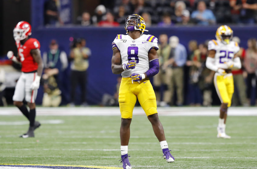 ATLANTA, GEORGIA - DECEMBER 07: Patrick Queen #8 of the LSU Tigers celebrates in the second half against the Georgia Bulldogs during the SEC Championship game at Mercedes-Benz Stadium on December 07, 2019 in Atlanta, Georgia. (Photo by Kevin C. Cox/Getty Images)