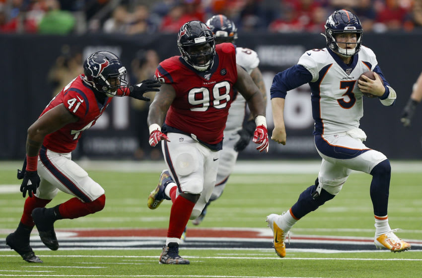 HOUSTON, TEXAS - DECEMBER 08: Drew Lock #3 of the Denver Broncos runs with the ball as D.J. Reader #98 of the Houston Texans and Zach Cunningham #41 pursue during the second half at NRG Stadium on December 08, 2019 in Houston, Texas. Denver defeated Houston 28-24. (Photo by Bob Levey/Getty Images)