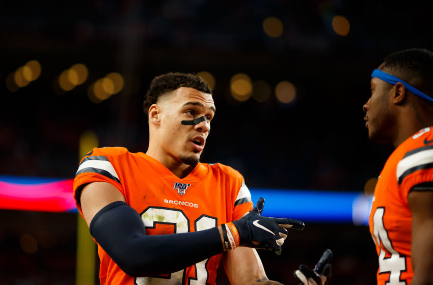 DENVER, CO - DECEMBER 22: Safety Justin Simmons #31 of the Denver Broncos talks with Safety Will Parks #34 of the Denver Broncos during the fourth quarter against the Detroit Lions at Empower Field at Mile High on December 22, 2019 in Denver, Colorado. The Broncos defeated the Lions 27-17. (Photo by Justin Edmonds/Getty Images)