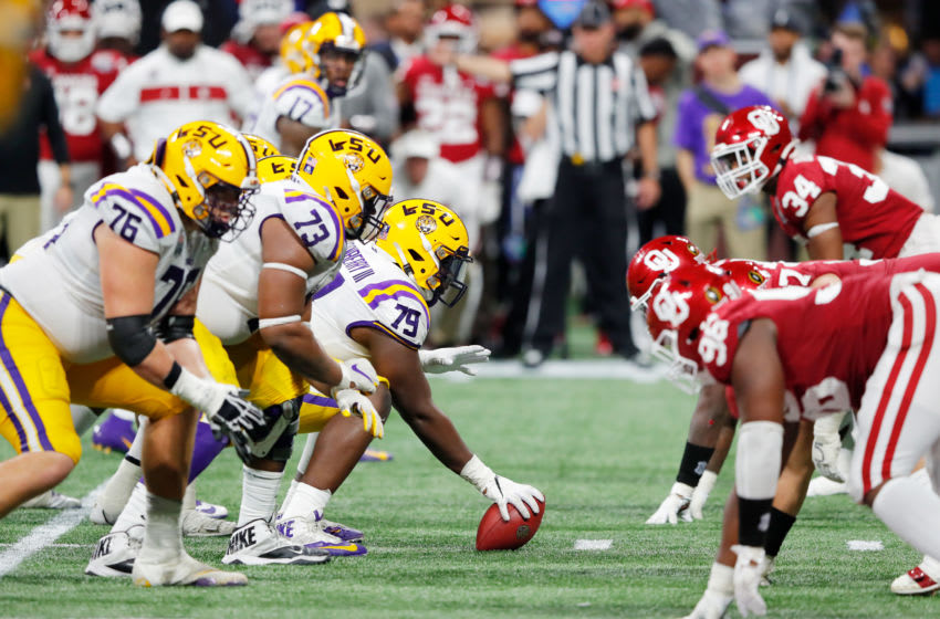 ATLANTA, GEORGIA - DECEMBER 28: Center Lloyd Cushenberry III #79 of the LSU Tigers on the line of scrimmage against the Oklahoma Sooners during the Chick-fil-A Peach Bowl at Mercedes-Benz Stadium on December 28, 2019 in Atlanta, Georgia. (Photo by Kevin C. Cox/Getty Images)