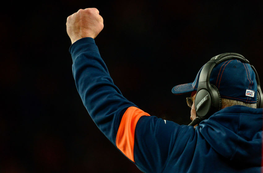 DENVER, CO - DECEMBER 29: Head coach Vic Fangio of the Denver Broncos pumps his fist after a turnover during a game against the Oakland Raiders at Empower Field at Mile High on December 29, 2019 in Denver, Colorado. (Photo by Dustin Bradford/Getty Images)