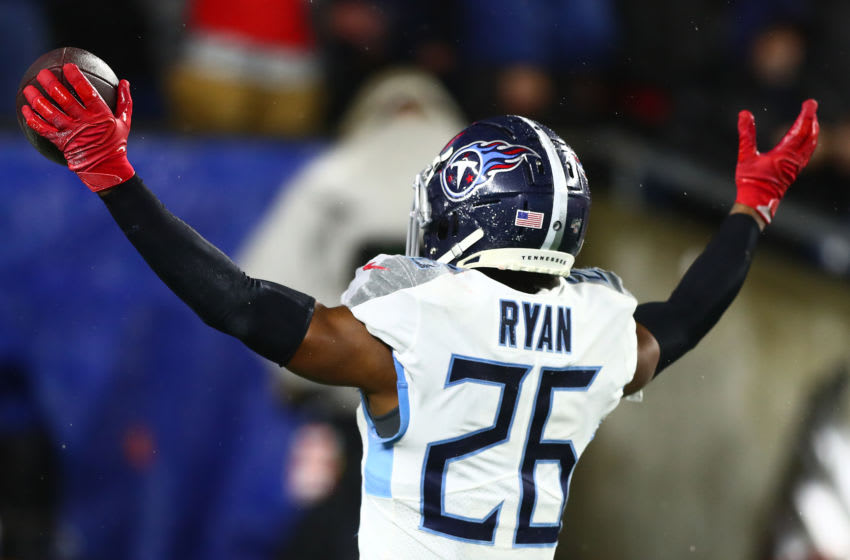 FOXBOROUGH, MASSACHUSETTS - JANUARY 04: Logan Ryan #26 of the Tennessee Titans celebrates his touchdown against the New England Patriots in the fourth quarter of the AFC Wild Card Playoff game at Gillette Stadium on January 04, 2020 in Foxborough, Massachusetts. (Photo by Adam Glanzman/Getty Images)