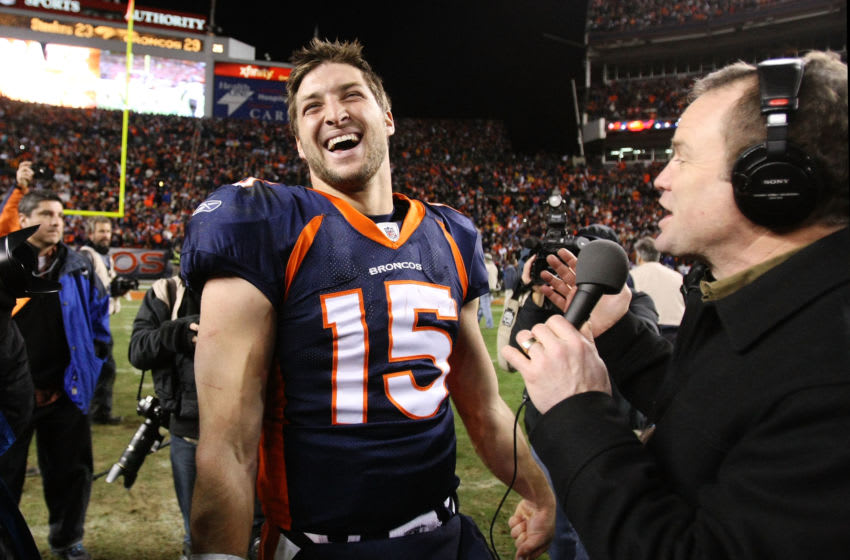 DENVER, CO - JANUARY 08: Tim Tebow #15 of the Denver Broncos talks to the media after defeating the Pittsburgh Steelers in overtime of the AFC Wild Card Playoff game at Sports Authority Field at Mile High on January 8, 2012 in Denver, Colorado. The Denver Broncos defeated the the Pittsburgh Steelers in overtime 23 - 29. (Photo by Jeff Gross/Getty Images)