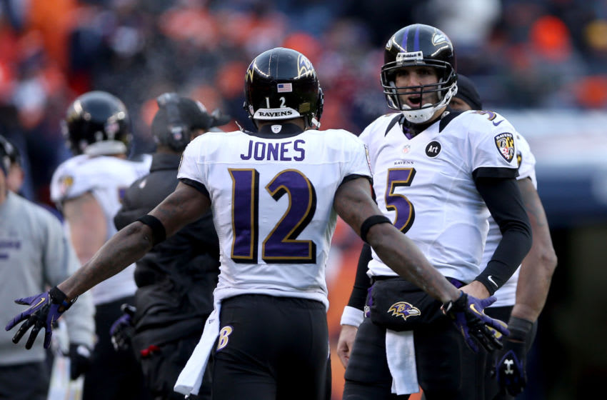 DENVER, CO - JANUARY 12: Joe Flacco #5 of the Baltimore Ravens celebrates with Jacoby Jones #12 against the Denver Broncos during the AFC Divisional Playoff Game at Sports Authority Field at Mile High on January 12, 2013 in Denver, Colorado. (Photo by Jeff Gross/Getty Images)