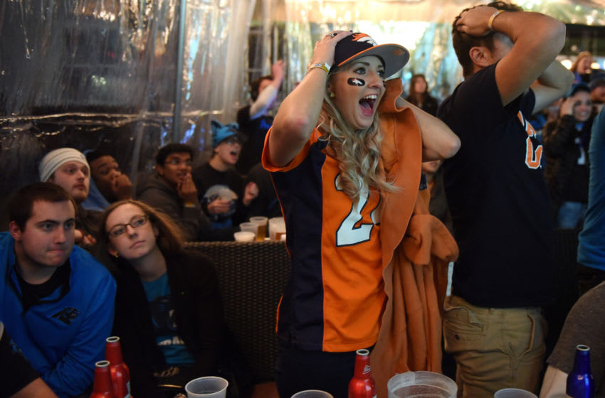 CHARLOTTE, NC - FEBRUARY 07: A fan of the Denver Broncos celebrates while watching Super Bowl 50 on February 7, 2016 at Rooftop 210 in the EpiCentre area of uptown Charlotte, North Carolina. (Photo by Lance King/Getty Images)