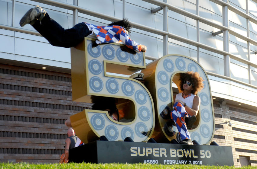 DENVER, CO - SEPTEMBER 08: Fans pose on a Super Bowl 50 statue before the Denver Broncos take on the Carolina Panthers at Sports Authority Field at Mile High on September 8, 2016 in Denver, Colorado. (Photo by Daniel Brenner/Getty Images)