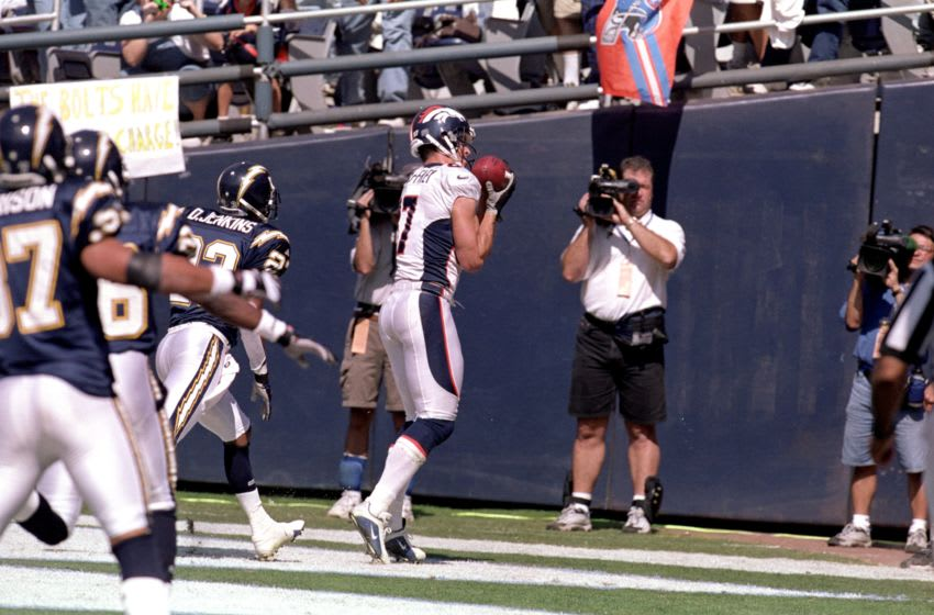 8 Oct 2000: Ed McCaffrey #87 of the Denver Broncos catches the ball in the endzone during a game against the San Diego Chargers at Qualcomm Stadium in San Diego, California. The Broncos defeated the Chargers 21-7.Mandatory Credit: Stephen Dunn /Allsport