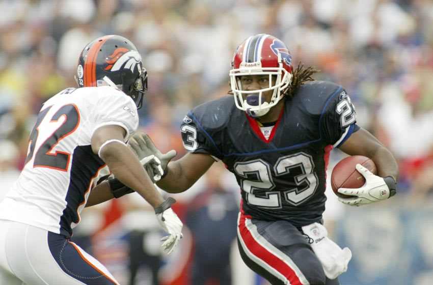 ORCHARD PARK, NY - SEPTEMBER 9: Marshawn Lynch #23 of the Buffalo Bills runs as Dre Bly #32 of the Denver Broncos defends at Ralph Wilson Stadium September 9, 2007 in Orchard Park, New York. Denver won 15-14. (Photo by Rick Stewart/Getty Images)