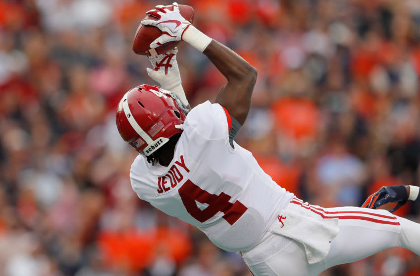 AUBURN, AL - NOVEMBER 25: Jerry Jeudy #4 of the Alabama Crimson Tide catches a touchdown pass during the second quarter against the Auburn Tigers at Jordan Hare Stadium on November 25, 2017 in Auburn, Alabama. (Photo by Kevin C. Cox/Getty Images)