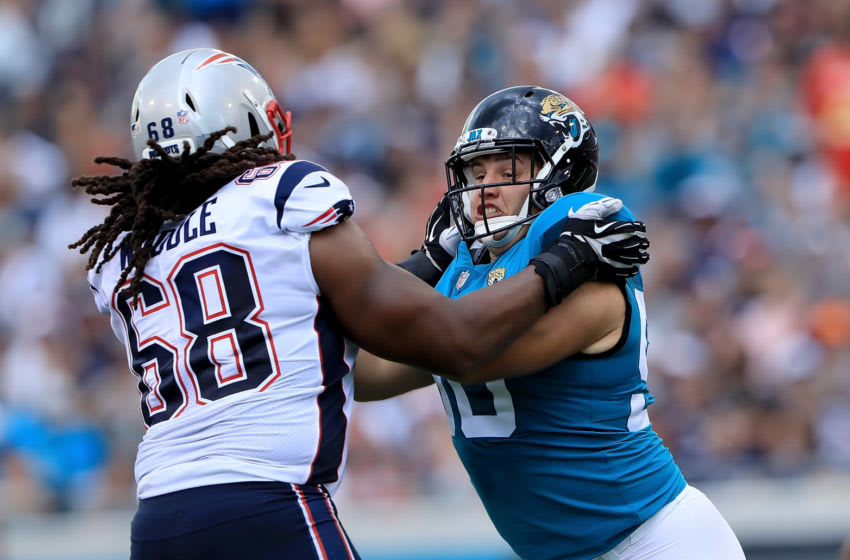 JACKSONVILLE, FL - SEPTEMBER 16: Taven Bryan #90 of the Jacksonville Jaguars attempts to run past LaAdrian Waddle #68 of the New England Patriots during the game at TIAA Bank Field on September 16, 2018 in Jacksonville, Florida. (Photo by Sam Greenwood/Getty Images)