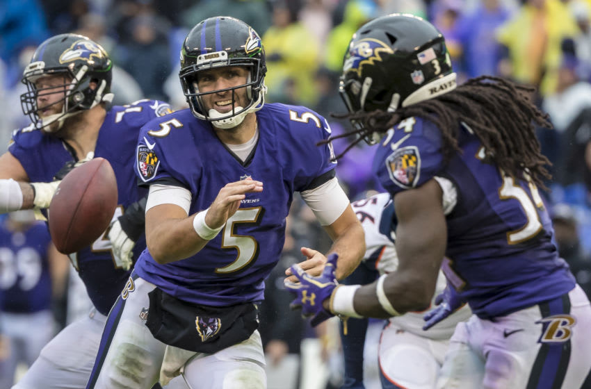 BALTIMORE, MD - SEPTEMBER 23: Joe Flacco #5 of the Baltimore Ravens pitches to Alex Collins #34 as Derek Wolfe #95 of the Denver Broncos pursues during the second half at M&T Bank Stadium on September 23, 2018 in Baltimore, Maryland. (Photo by Scott Taetsch/Getty Images)