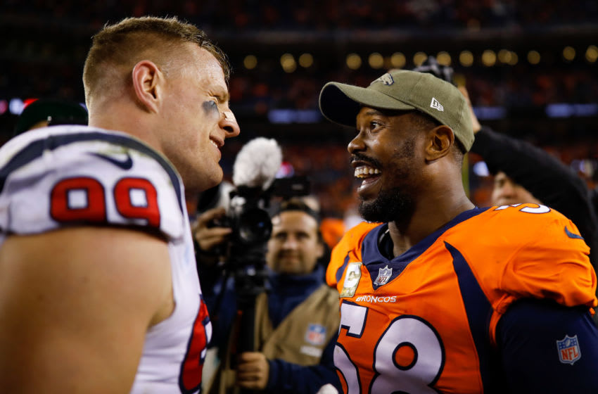DENVER, CO - NOVEMBER 4: Outside linebacker Von Miller #58 of the Denver Broncos has a word with defensive end J.J. Watt #99 of the Houston Texans after a 19-17 Texans' win at Broncos Stadium at Mile High on November 4, 2018 in Denver, Colorado. (Photo by Justin Edmonds/Getty Images)