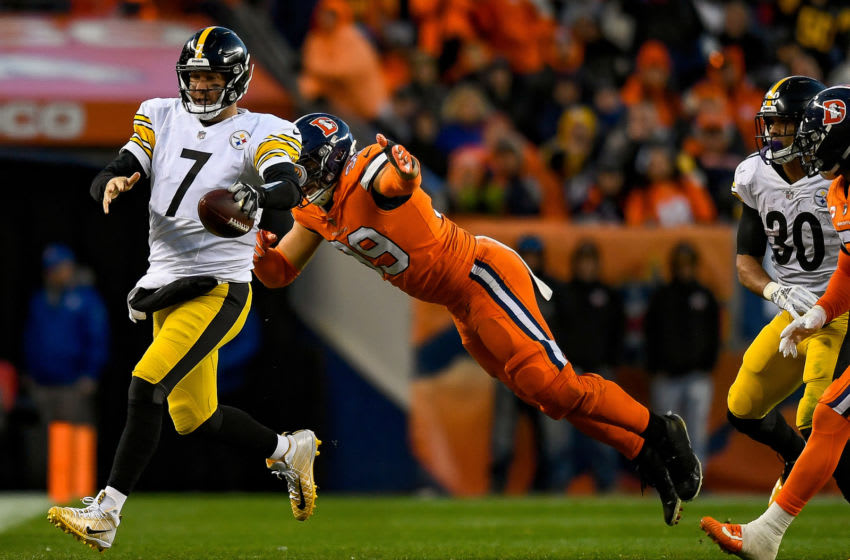 DENVER, CO - NOVEMBER 25: Quarterback Ben Roethlisberger #7 of the Pittsburgh Steelers carries the ball for a small gain as defensive end Adam Gotsis #99 of the Denver Broncos dives to make a tackle in the third quarter of a game at Broncos Stadium at Mile High on November 25, 2018 in Denver, Colorado. (Photo by Dustin Bradford/Getty Images)