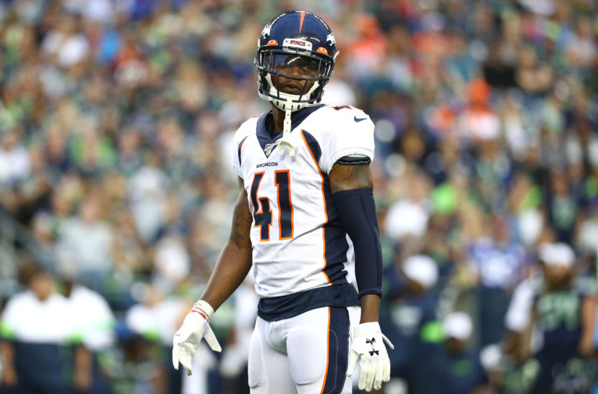 SEATTLE, WASHINGTON - AUGUST 08: DeVante Bausby #41 of the Denver Broncos looks on against the Seattle Seahawks in the second quarter during their preseason game at CenturyLink Field on August 08, 2019 in Seattle, Washington. (Photo by Abbie Parr/Getty Images)