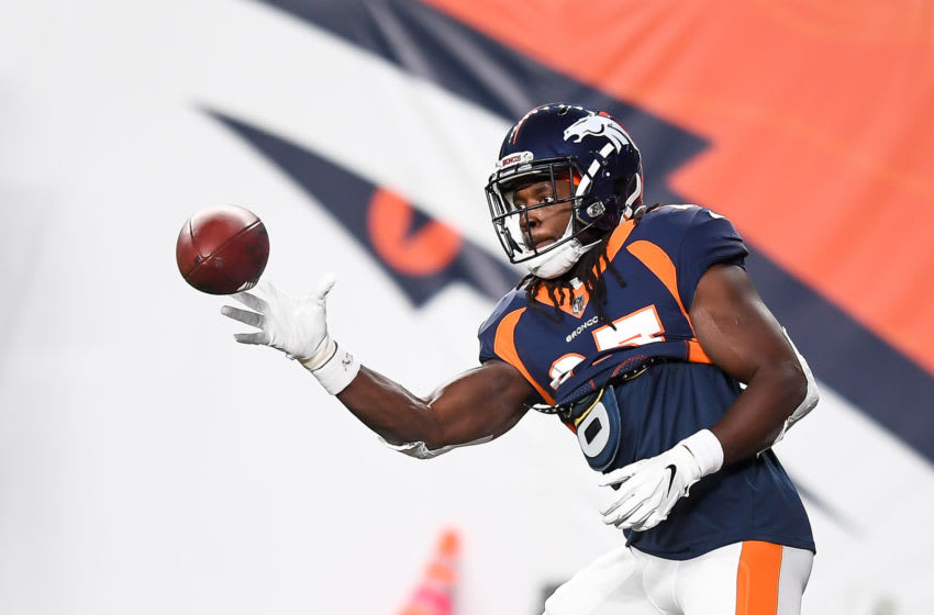 DENVER, CO - SEPTEMBER 14: Melvin Gordon III #25 of the Denver Broncos catches a ball one-handed as he warms up before a game against the Tennessee Titans at Empower Field at Mile High on September 14, 2020 in Denver, Colorado. (Photo by Dustin Bradford/Getty Images)