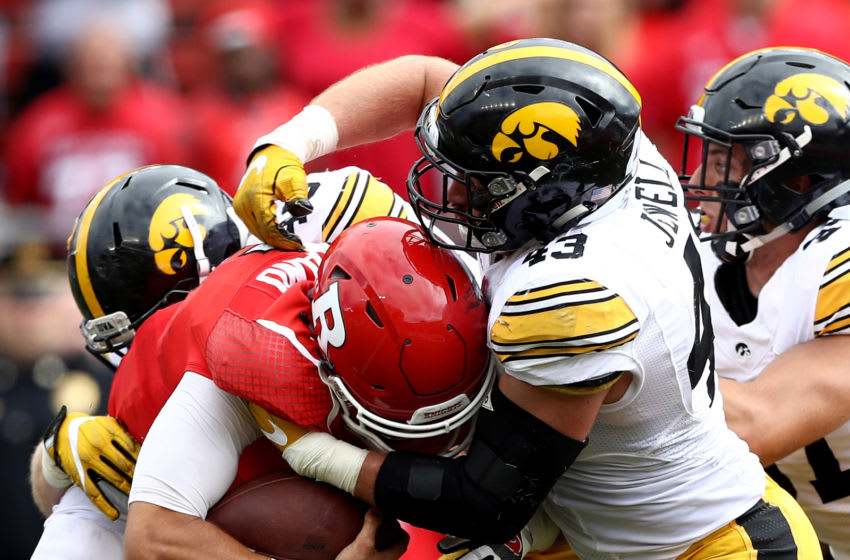 PISCATAWAY, NJ - SEPTEMBER 24: Chris Laviano #5 of the Rutgers Scarlet Knights carries the ball as Josey Jewell #43 of the Iowa Hawkeyes defends at High Point Solutions Stadium on September 24, 2016 in Piscataway, New Jersey. (Photo by Elsa/Getty Images)