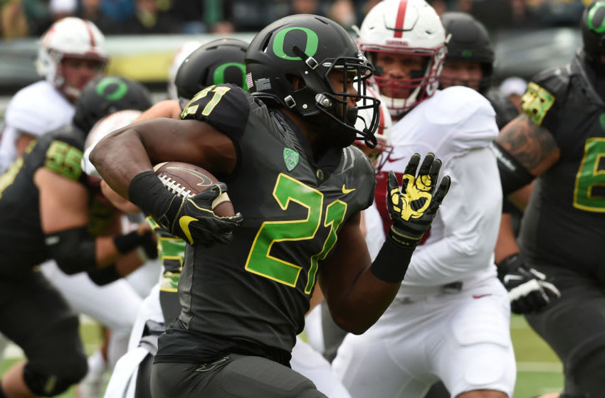 EUGENE, OR - NOVEMBER 12: Running back Royce Freeman #21 of the Oregon Ducks runs with the ball during the first quarter of the game against the Stanford Cardinal at Autzen Stadium on November 12, 2016 in Eugene, Oregon. (Photo by Steve Dykes/Getty Images)