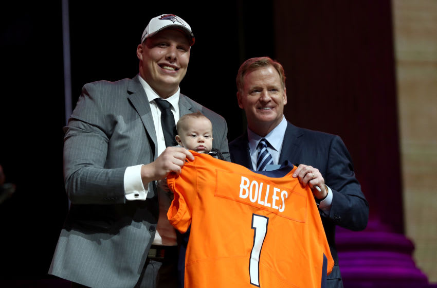PHILADELPHIA, PA - APRIL 27: (L-R) Garett Bolles of Utah and his son Kingston pose with Commissioner of the National Football League Roger Goodell after being picked #20 overall by the Denver Broncosduring the first round of the 2017 NFL Draft at the Philadelphia Museum of Art on April 27, 2017 in Philadelphia, Pennsylvania. (Photo by Elsa/Getty Images)