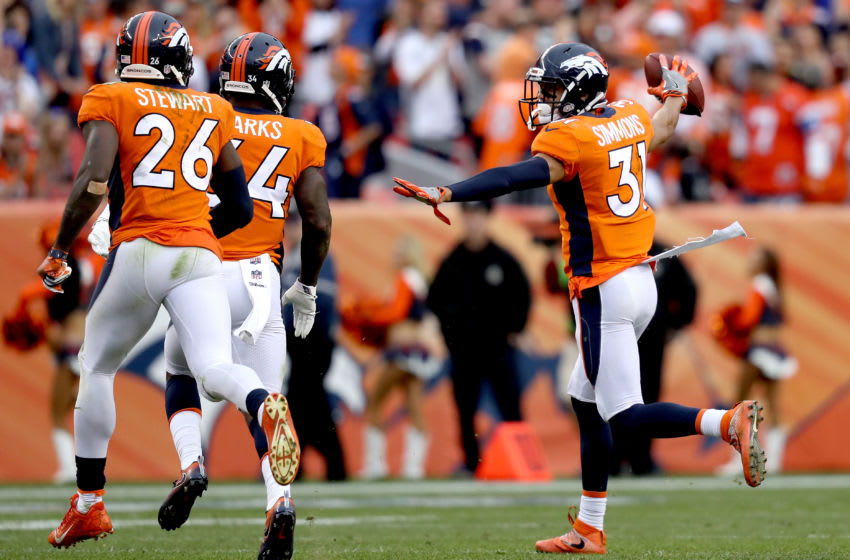 DENVER, CO - OCTOBER 01: Justin Simmons #31 of the Denver Broncos celebrates making an interception late in the fourth quarter against the Oakland Raiders at Sports Authority Field at Mile High on October 1, 2017 in Denver, Colorado. (Photo by Matthew Stockman/Getty Images)