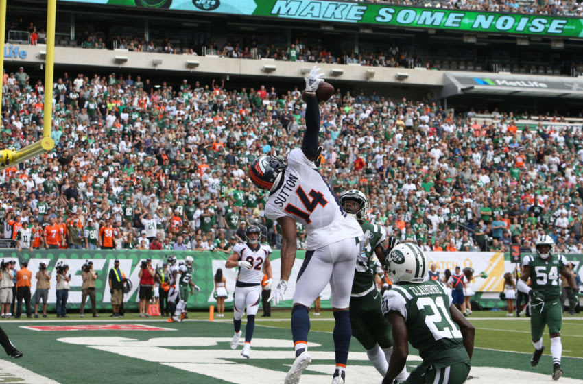 EAST RUTHERFORD, NJ - OCTOBER 07: Wide Receiver Courtland Sutton #14 of the Denver Broncos reaches for a pass in the end zone against the New York Jets on October 7, 2018 at MetLife Stadium in East Rutherford, NJ. (Photo by Al Pereira/Getty Images)