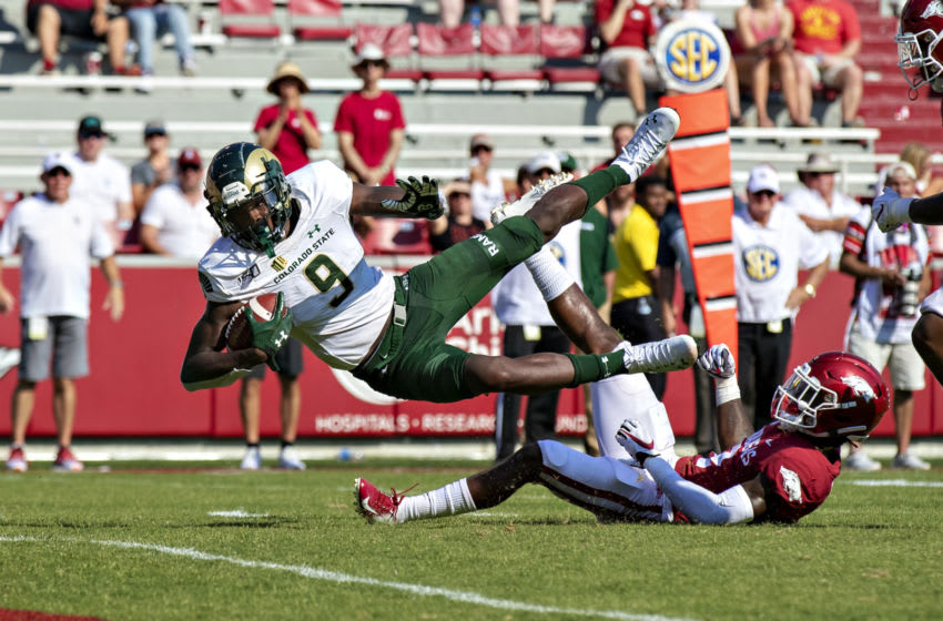 FAYETTEVILLE, AR - SEPTEMBER 14: Warren Jackson #9 of the Colorado State Rams dives to the one yard line after being tripped by Kamren Curl #2 of the Arkansas Razorbacks at Razorback Stadium on September 14, 2019 in Fayetteville, Arkansas. (Photo by Wesley Hitt/Getty Images)