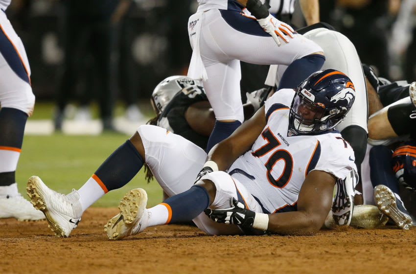 OAKLAND, CALIFORNIA - SEPTEMBER 09: Ja'Wuan James #70 of the Denver Broncos holds his leg as he lays on the ground in the first half against the Oakland Raiders at RingCentral Coliseum on September 09, 2019 in Oakland, California. (Photo by Lachlan Cunningham/Getty Images)