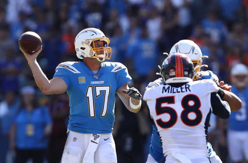 CARSON, CALIFORNIA - OCTOBER 06: Philip Rivers #17 of the Los Angeles Chargers looks to pass as Von Miller #58 of the Denver Broncos defends during the second half of a game at Dignity Health Sports Park on October 06, 2019 in Carson, California. (Photo by Sean M. Haffey/Getty Images)